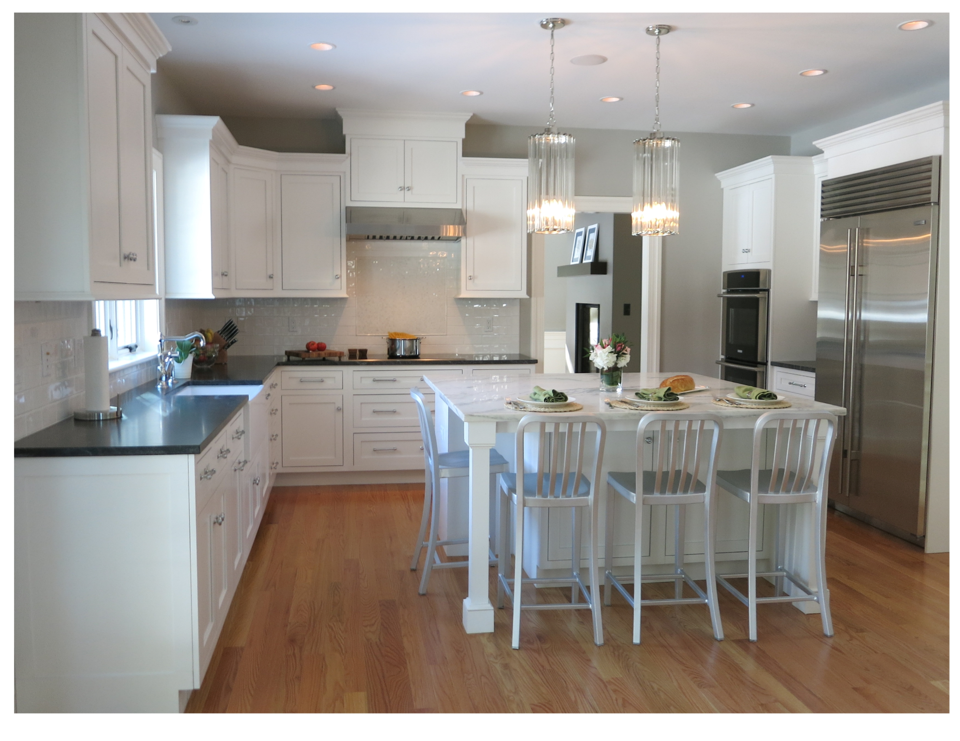 Great Northern White painted inset cabinets with Jet Mist countertops