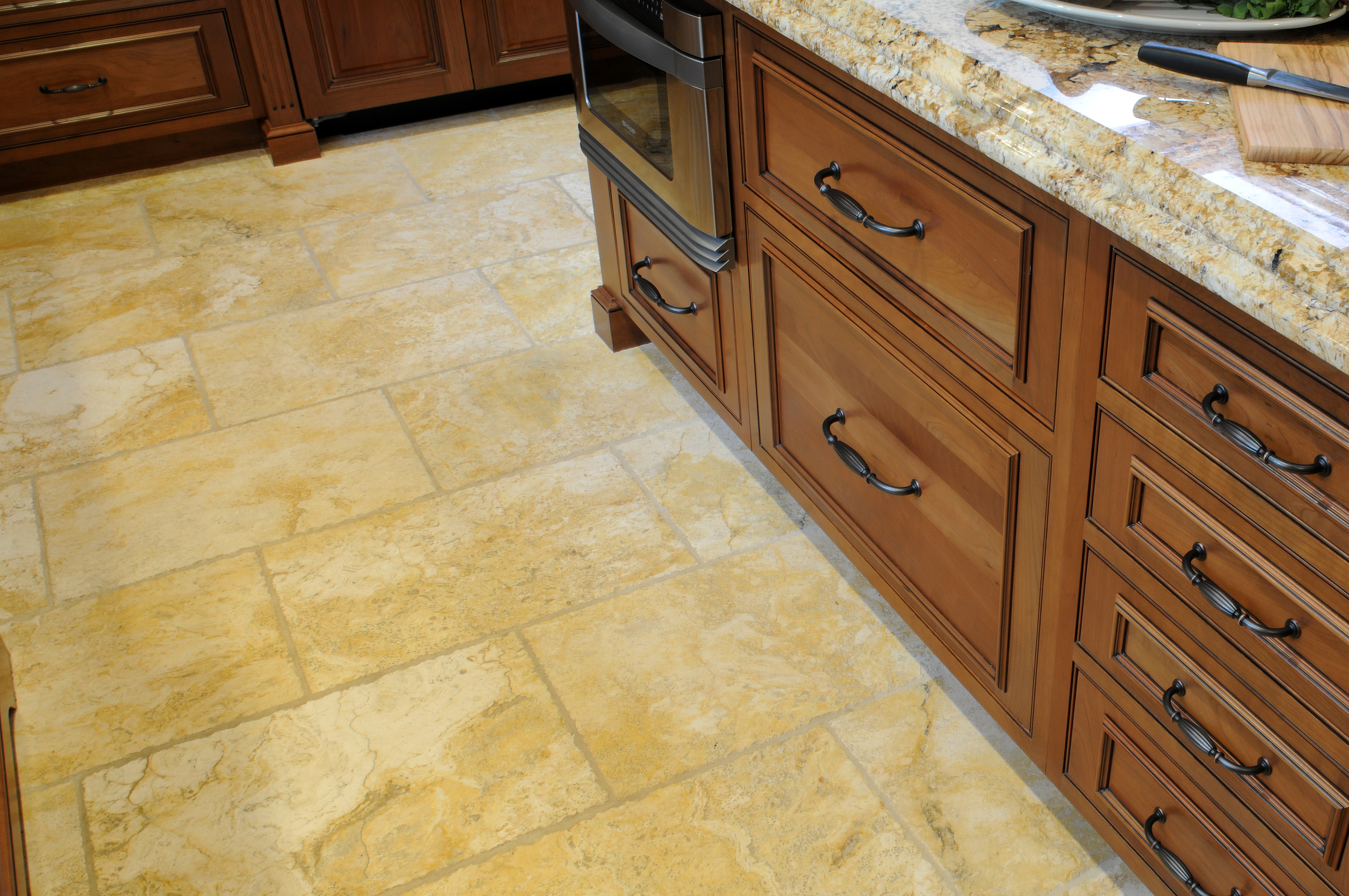 cabinetry blog | natural stone floor