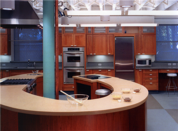Cherry Shaker design cabinets with glass fronts.