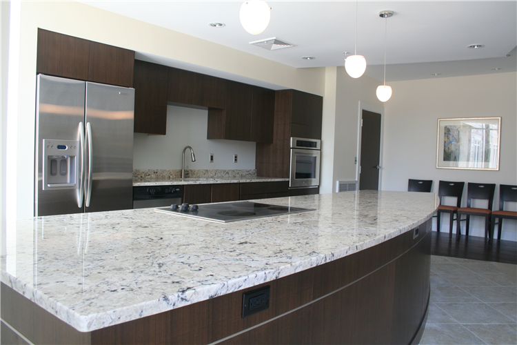 Maple cabinetry, stained a rich color with stainless appliances and trim.
