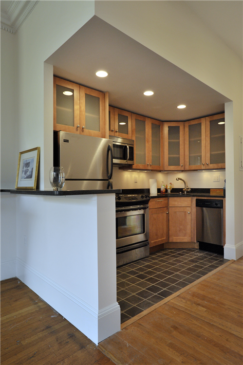 Maple stained full overlay cabinetry
