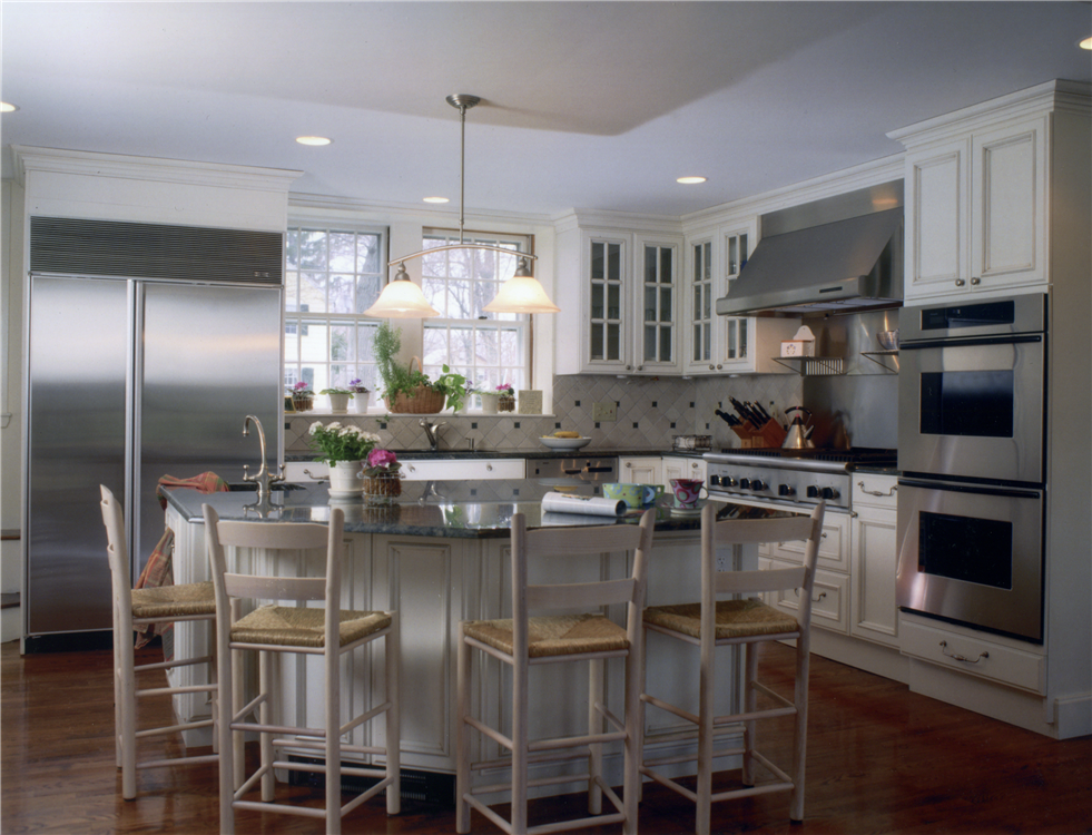 White painted full overlay cabinetry