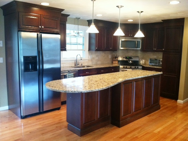 Stained cherry full overlay cabinetry