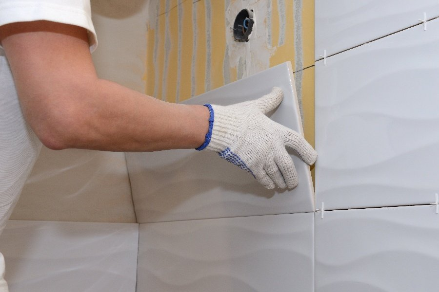 tile the floor or walls first in a bathroom